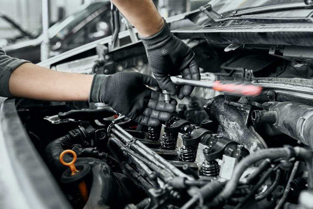 Repairman Fixing Car