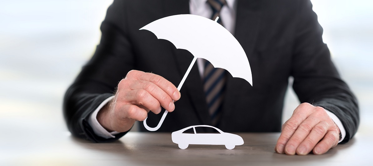 Businessman holding umbrella over car cutout