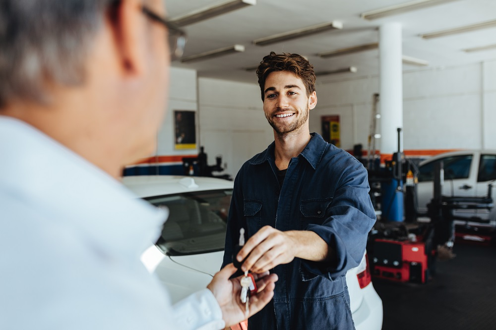 Mechanic giving keys back to customer